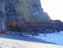 I reached the cliffs at the end of the beach but did not linger long under them.