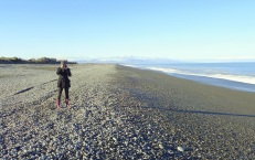 Taking a photo of Petra taking a photo - looking northeast back towards Banks Peninsula and Birdlings Flat