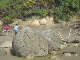 The boulders originate in thecliffs behind the beach