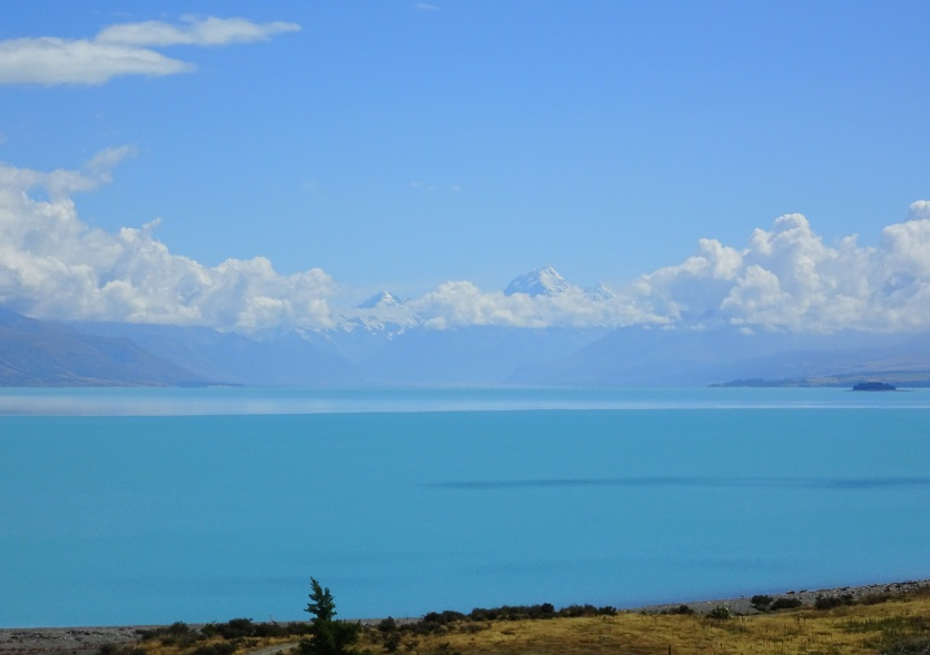 Lake Teakapo, with Aoraki/Mt Cook in the distant clouds