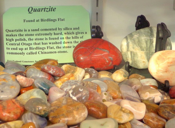 Part of the Quartzite Collection at the Birdlings Flat Gemstone and Fossil Museum. At top right is a large white-grey stone, with a fault through it. Photos with permission