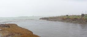 Mouth of the Hokitika River, looking north at Hokitika on the far shore.