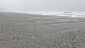 Drifts of stones on the beach near Hokitika.