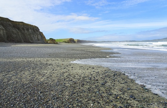 Gemstone Beach, looking back towards Taunoa Stream (at the small break in cliffs)