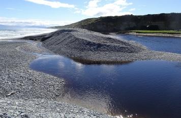 September 2018 - Waimeamea River has temporarily broken through the stone bank.
