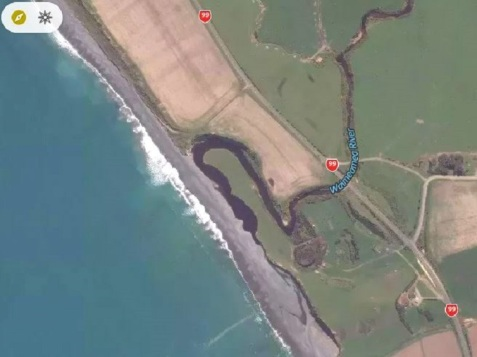 The Waimeamea River builds up a lagoon behind the large bank of stones thrown up by the sea. Source: Mapcarta.