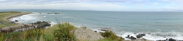 Panorama of Riverton's Back Beach - Bluff Hill in the middle far distance, Stewart Island/Rakiura to the right, in the mist on the horizon, across Foveaux Strait