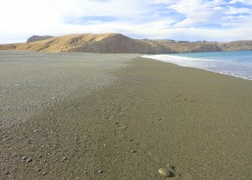 Kaitorete Spit, a 25 kms long gravel bank, looking towards Banks Peninsula, separating Lake Ellesmere from the Pacific Ocean