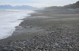 Sand and stones on the beach near McCracken's Rest