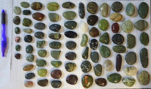 78 polished stones collected from Riverton's Back Beach in March 2019, set out just having been dried from the opened barrel