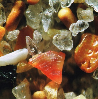 """Sand from Geriba Beach, Brazil, magnified 300x. Source: Page 18 of """"A Grain of Sand: Nature's Secret Wonder"""" by Gary Greenberg (2008)"""