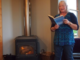 Kay reading poetry at the Orepuki Beach Cafe, 2015. Source: http://whistlestoptours.blogspot.com/2015/06/early-march-2015-saw-j-and-k-rolling.html
