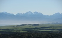 The McKenzie farm at Orepuki, Princess Range in the background, Te Waewae Bay to the left. Source: https://bellamysatfive.wordpress.com/the-poets/kay-mckenzie-cooke