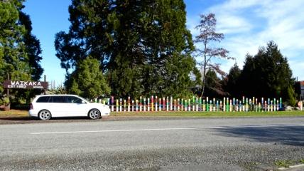 Kay's car parked alongside the school fence when she visited Waikaka school. Source: https://kaymckenziecooke.com/2018/08/05/waikaka-visit/