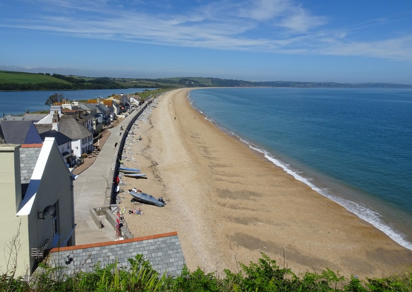 Slapton Sands beach, with the village of Torcross below and Slapton Ley to the left