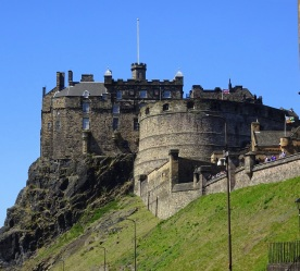 """Edinburgh Castle, sited on a hard plug of igneous dolerite. This photo is taken from the """"tail"""", the top of the Royal Mile."""