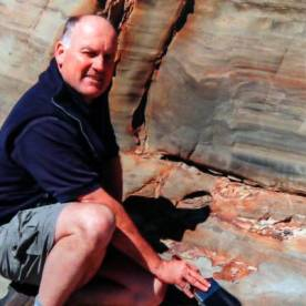 Dr Greg Browne, who discovered the 70 million year old dinosaur trace fossil footprints near Westhaven Inlet, northwest Nelson, in 2009. Source: https://www.stuff.co.nz/nelson-mail/opinion/78239864/on-trail-of-dinosaurs-in-golden-bay