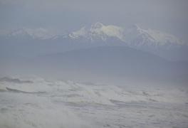 The mountains of Fiorland and the wild sea of Te Waewae Bay