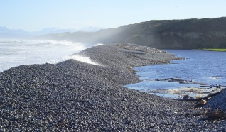 The occasional wave lapping over the stone bank at Waimeamea River mouth/lagoon.