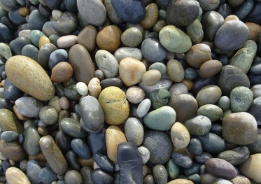 Some of the larger Gemstone Beach stones that appear as you move closer to the Waimeamea River mouth, though smaller ones continue to predominate.